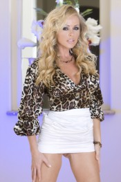 Stunning blonde, Dyanna Lauren, shows just how wild she can get stripping out of her sexy leapord print blouse and tight white skirt!