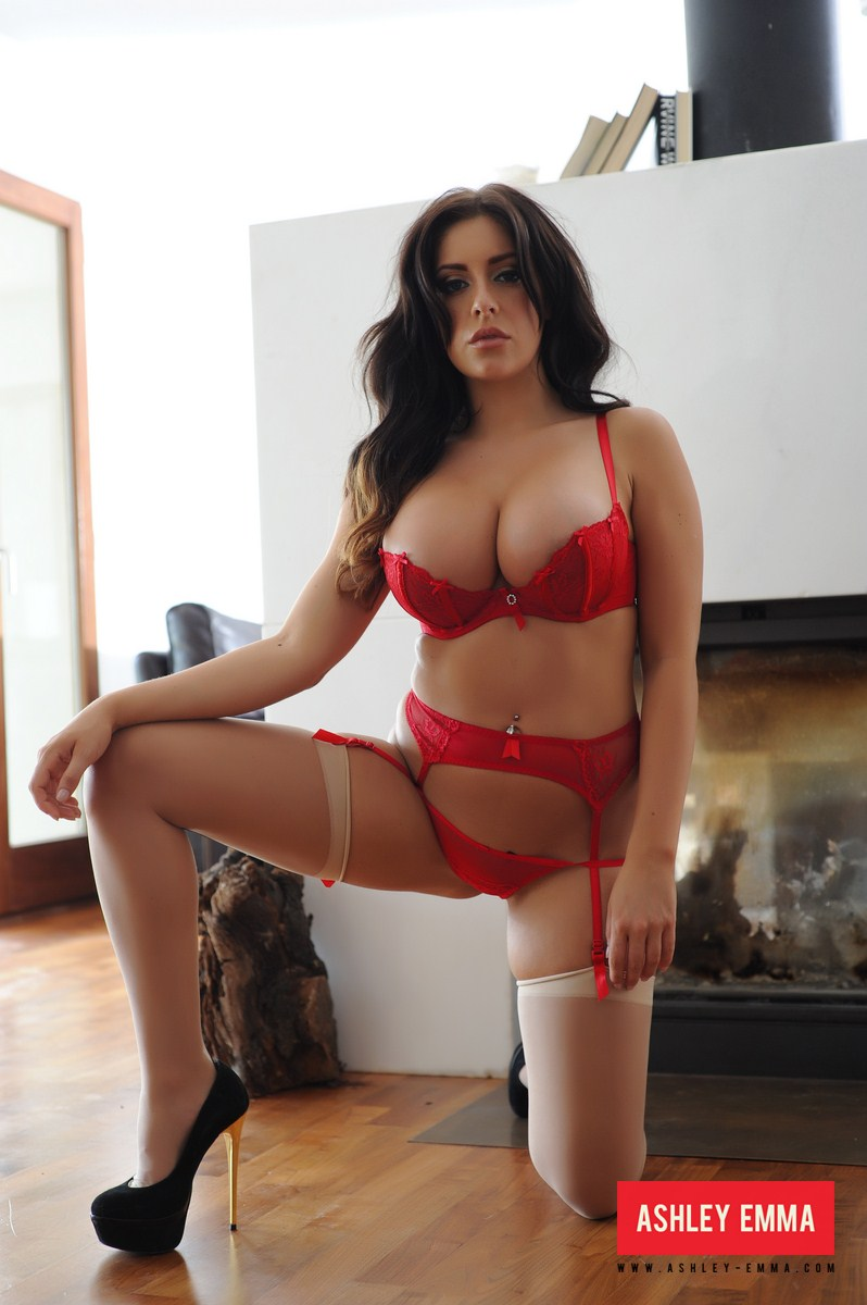 Ashley Emma strips in her livingroom from her cute red